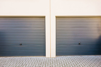 two-grey-garage-doors-on-260nw-748203634